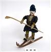 Leksak, man på skidor